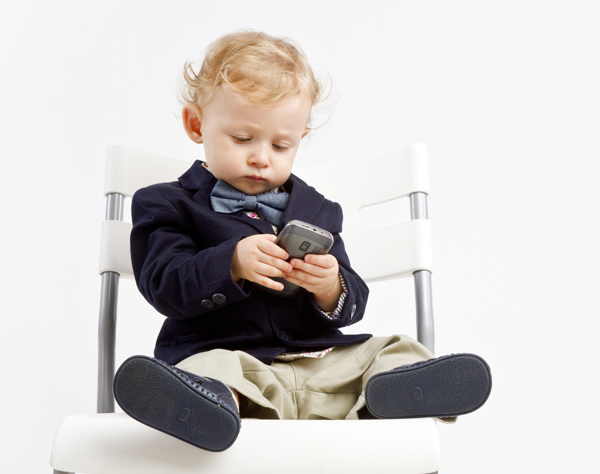 http://www.dreamstime.com/royalty-free-stock-photography-business-baby-phone-dressed-outfit-texting-smart-image45125717